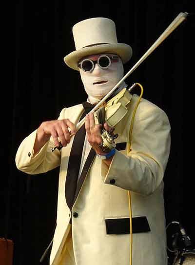 Nash the Slash performing in trademark bandages